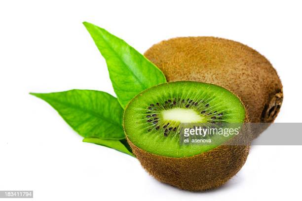 Kiwi fruits with one cut in halves, exposing the green flesh