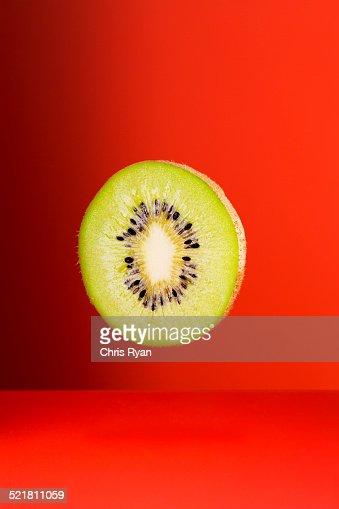 Kiwi slice on red counter