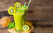 kiwi smoothies juice,beverage healthy the taste yummy In glass,drink episode morning on old wood.
