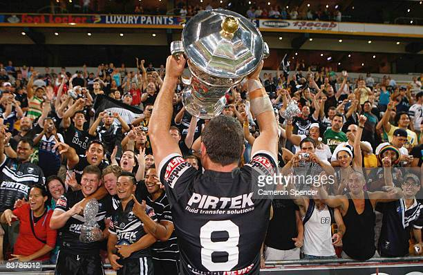 Kiwis captain Nathan Cayless presents the world cup trophy to the crowd after winning the 2008 Rugby League World Cup Final match between the...