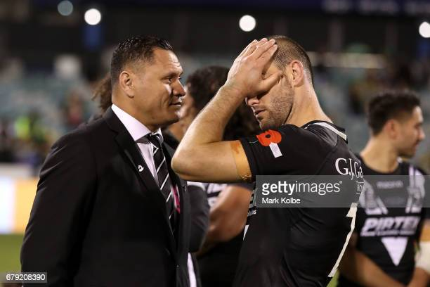Kiwis coach David Kidwell and Simon Mannering of the Kiwis look dejected after defeat during the ANZAC Test match between the Australian Kangaroos...