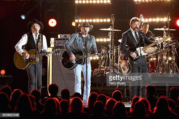 Kix Brooks of Brooks and Dunn Jason Aldean and Ronnie Dunn of Brooks and Dunn perform onstage at the 50th annual CMA Awards at the Bridgestone Arena...