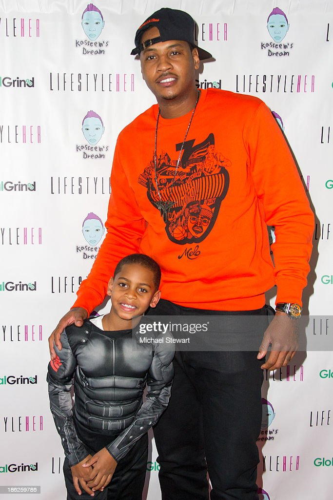 Kiyan Carmelo Anthony (L) and New York Knicks player Carmelo Anthony attend Flipeez Presents Kasseem's Dream Halloween Party at BKLYN BEAST on October 29, 2013 in Brooklyn, New York.