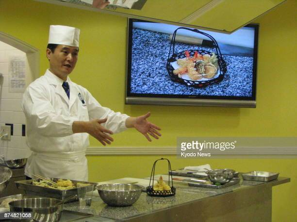 Kiyoaki Deki technical director of Japanese cuisine at Le Cordon Bleu's Tokyo campus teaches a class on tempura fried dishes on Oct 31 2017 ==Kyodo