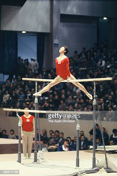 Kiyoko Ono of Japan competes in the Uneven Bars of the Women's Artistic Gymnastics Individual AllAround during the Tokyo Olympics at Tokyo...