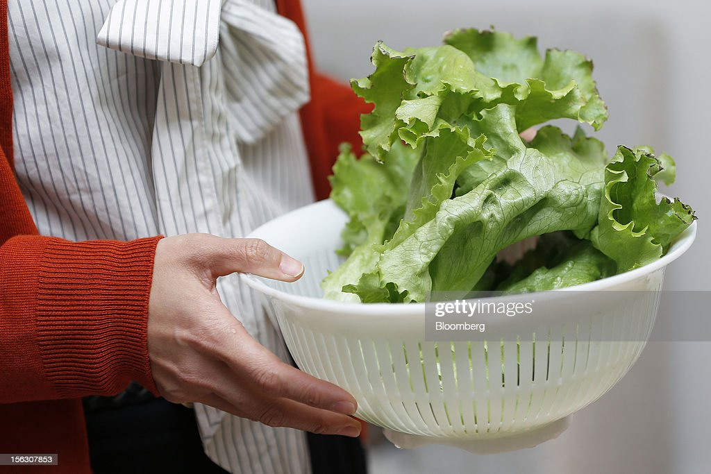 Kiyomi Ogawa, 38, holds a bowl of lettuce produced using a prototype of a home-use mini 'plant factory' manufactured by Panasonic Corp. at her house in Kashiwa City, Chiba Prefecture, Japan, on Monday, Nov. 12, 2012. Japanese consumers are closing their wallets as the economy's outlook darkens, making it harder for Prime Minister Yoshihiko Noda to stave off the nation's third recession in four years. Photographer: Kiyoshi Ota/Bloomberg via Getty Images