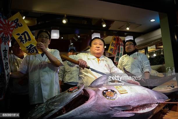 Kiyoshi Kimura president of Kiyomura KK center poses with a newlypurchased tuna at Sushi Zanmai restaurant in Tokyo Japan on Tuesday Jan 5 2017...