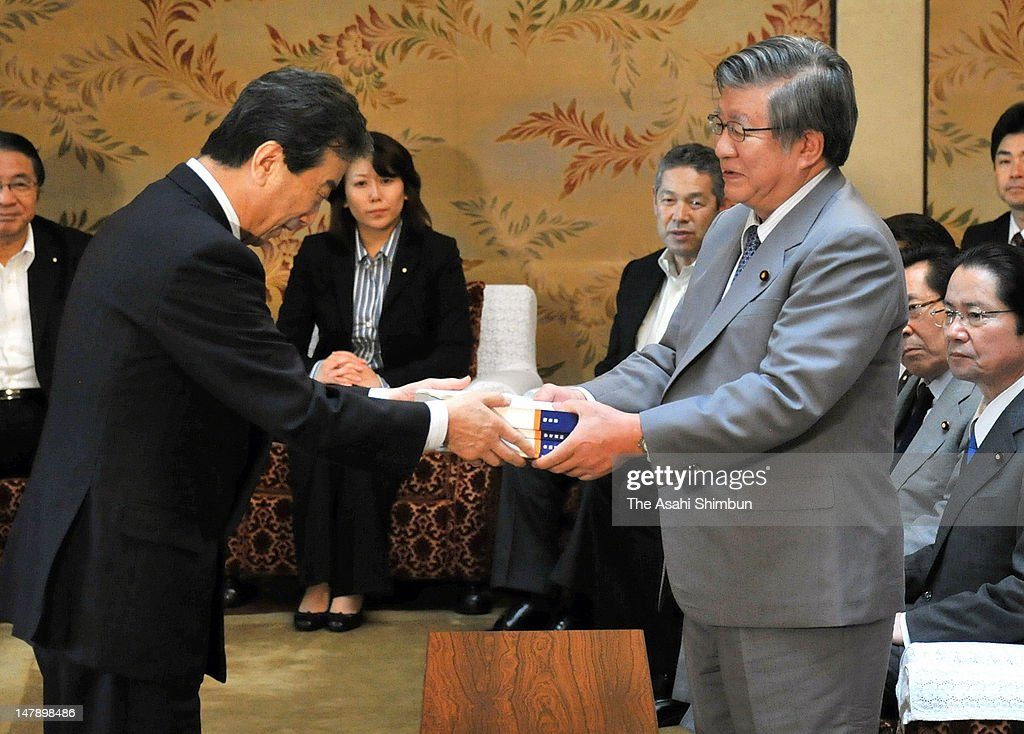 Kiyoshi Kurokawa (L), head of the Fukushima Nuclear Accident Independent Investigation Commission, submits its final report to Lower House Speaker Takahiro Yokomichi (R) at the diet building on July 5, 2012 in Tokyo, Japan. Lambasting both Tokyo Electric Power Co. and the prime minister's office, the fianl report recommended an overhaul of the government's crisis management system.
