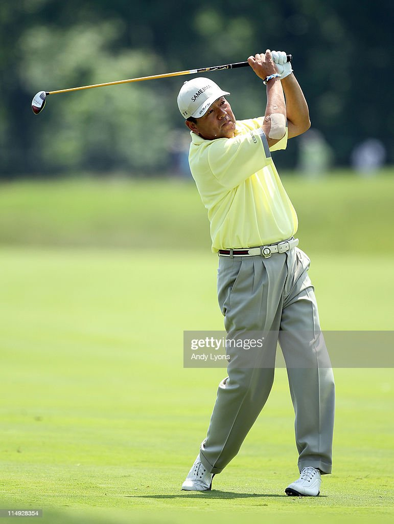 Kiyoshi Murota of Japan hits his second shot on the par 5 7th hole during the Senior PGA Championship presented by KitchenAid at Valhalla Golf Club on May 29, 2011 in Louisville, Kentucky.