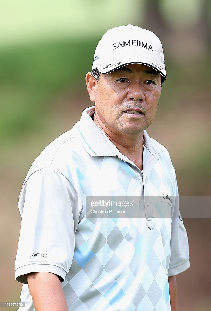 <a gi-track='captionPersonalityLinkClicked' href=/galleries/search?phrase=Kiyoshi+Murota&family=editorial&specificpeople=3076195 ng-click='$event.stopPropagation()'>Kiyoshi Murota</a> of Japan walks down the 14th hole during the first round of the 2014 U.S. Senior Open Championship at Oak Tree National on July 10, 2014 in Edmond, Oklahoma.