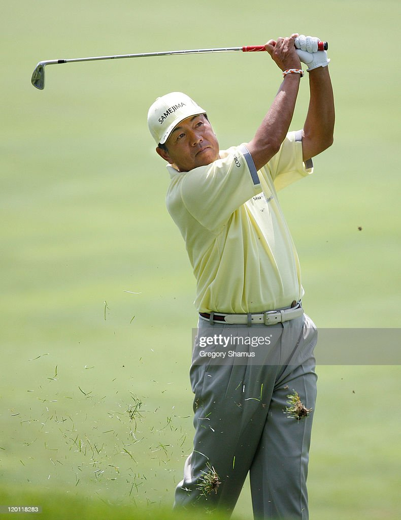 <a gi-track='captionPersonalityLinkClicked' href=/galleries/search?phrase=Kiyoshi+Murota&family=editorial&specificpeople=3076195 ng-click='$event.stopPropagation()'>Kiyoshi Murota</a> of Japan watches his shot from the sixth fairway during the third round of the United States Senior Open at the Inverness Club on July 30, 2011 in Toledo, Ohio.