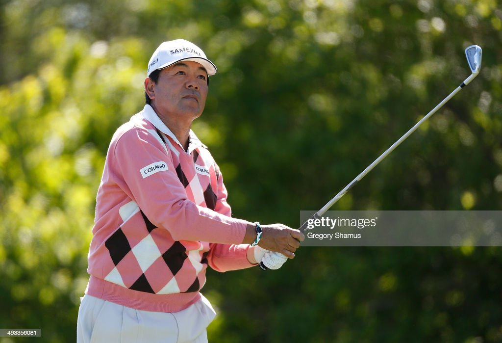 <a gi-track='captionPersonalityLinkClicked' href=/galleries/search?phrase=Kiyoshi+Murota&family=editorial&specificpeople=3076195 ng-click='$event.stopPropagation()'>Kiyoshi Murota</a> of Japan watches his tee shot on the fourth tee during the second round of the 2014 Senior PGA Championship presented by KitchenAid at the Golf Club at Harbor Shores on May 23, 2014 in Benton Harbor, Michigan.