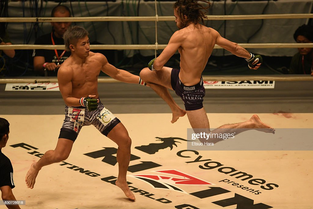 Kizaemon Saiga(L) of Japan and Dillin West of South Africa compete in the bout during the RIZIN Fighting World GP 2016 final round at Saitama Super Arena on December 31, 2016 in Saitama, Japan.