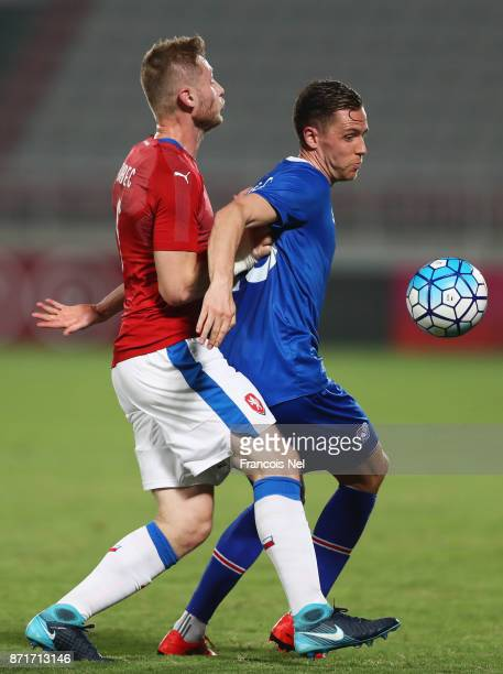 Kjartan Finnbogason of Iceland holds off Jakub Brabec of the Czech Republic during the international friendly match between Iceland and Czech...