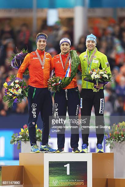 Kjeld Nuis and Kai Verbij of Netherlands and Nico Ihle of Germany pose in the Men's Sprint Medal Ceremony during day 2 of the European Speed Skating...