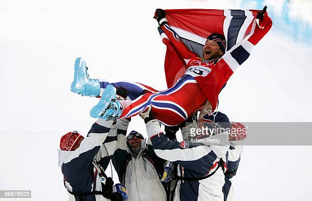 Kjetil Andre Aamodt of Norway is tossed up by teammates after he won the gold medal in the Mens SuperG Alpine Skiing Final on Day 8 of the 2006 Turin...