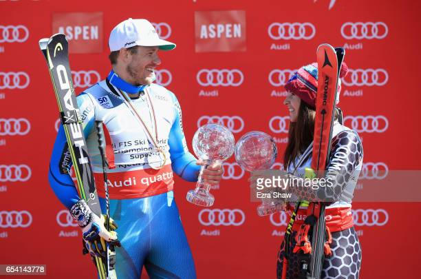 Kjetil Jansrud of Norway and Tina Weirather of Liechtenstein pose with their respective globes after winning the men's and ladies' SuperG season...