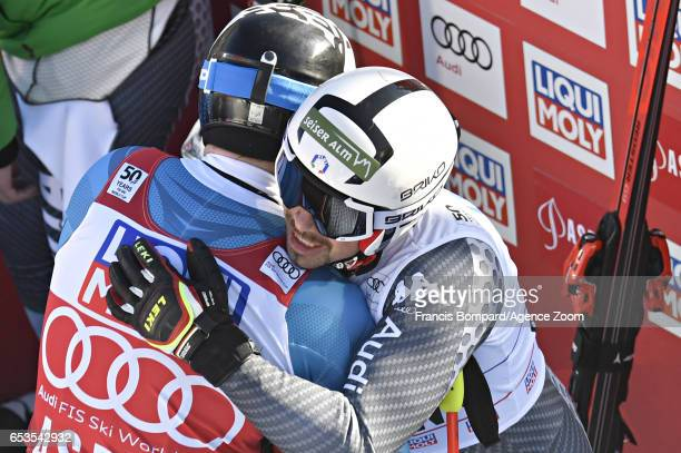 Kjetil Jansrud of Norway congratulates Peter Fill of Italy wins the globe in the overall standings during the Audi FIS Alpine Ski World Cup Finals...