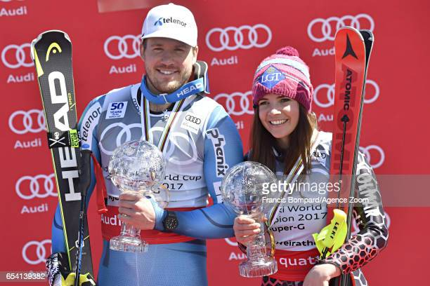 Kjetil Jansrud of Norway wins the globe in the overall standings Tina Weirather of Liechtenstein wins the globe in the overall standings during the...