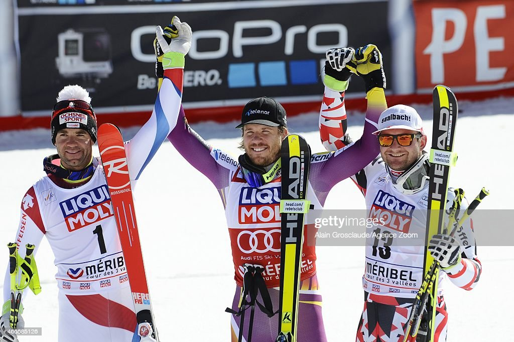 Kjetil Jansrud of Norway wins the race and the overall World Cup downhill globe Didier Defago of Switzerland takes 2nd place Georg Streitberger of...