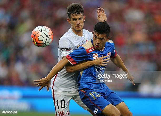 Kjie Lee of the Jets contests the ball with Dario Vidosic of the Wanderers during the round five ALeague match between the Newcastle Jets and the...