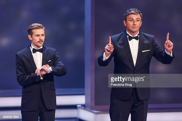 Klaas HeuferUmlauf and Hans Sigl attend the Deutscher Fernsehpreis 2014 show on October 02 2014 in Cologne Germany
