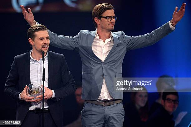 Klaas HeuferUmlauf and Joko Winterscheidt celebrate winning the 1Live Krone award during the 1Live Krone 2014 at Jahrhunderthalle on December 4 2014...