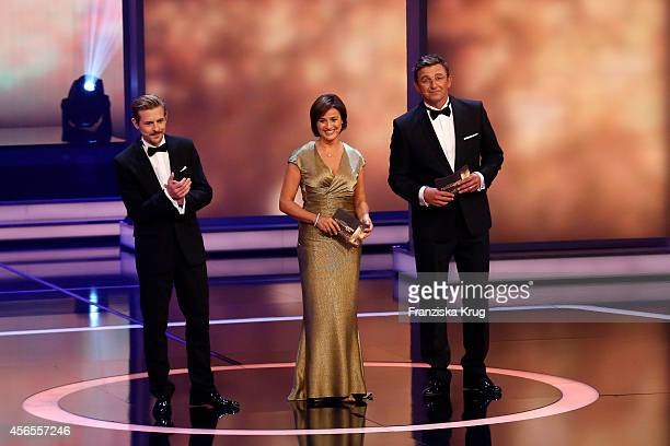 Klaas HeuferUmlauf Sandra Maischberger and Hans Sigl attend the Deutscher Fernsehpreis 2014 show on October 02 2014 in Cologne Germany