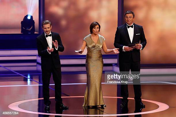 Klaas HeuferUmlauf Sandra Maischberger and Hans Sigl attend the Deutscher Fernsehpreis 2014 show on October 02 2014 in Cologne Germany