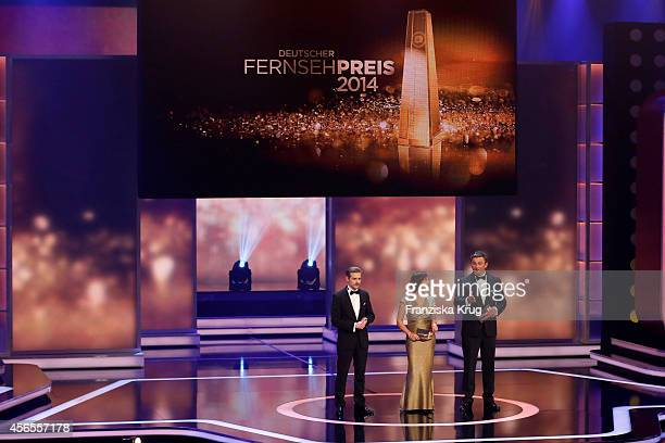 Klaas HeuferUmlauf Sandra Maischberger and Hans Sigl attends the Deutscher Fernsehpreis 2014 show on October 02 2014 in Cologne Germany