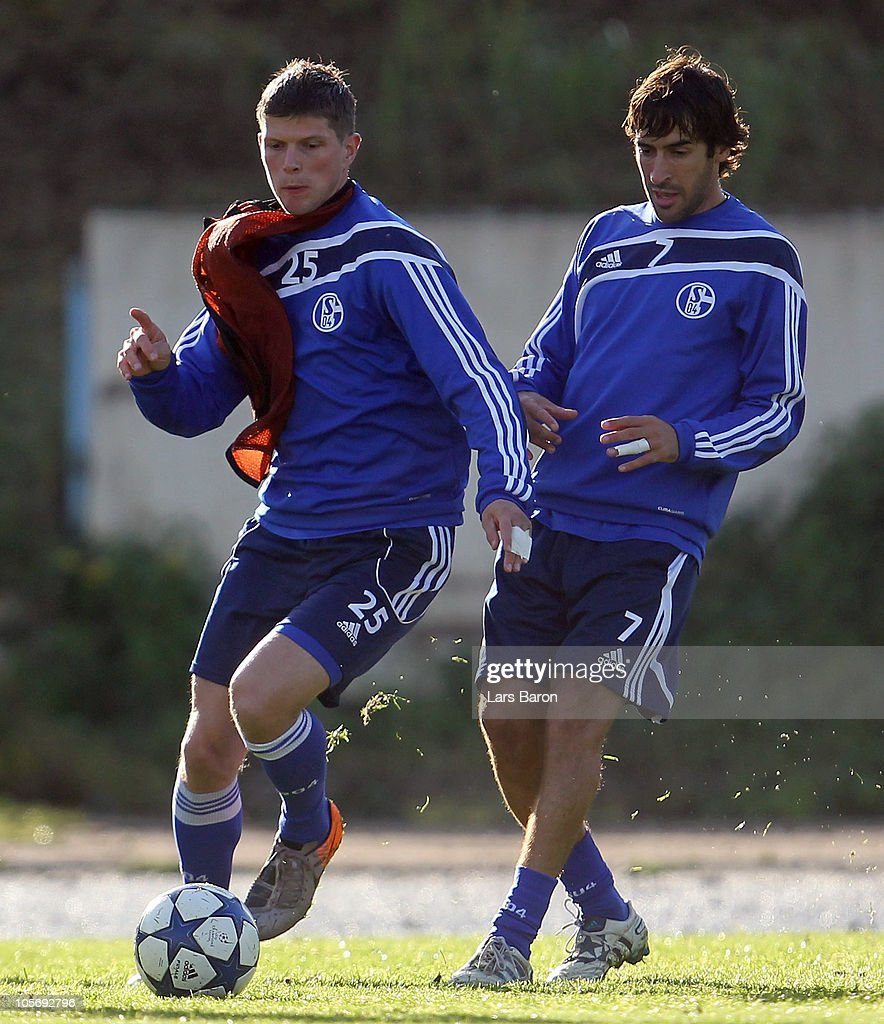 Klaas Jan Huntelaar is challenged by Raul Gonzales during a FC Schalke 04 training session ahead of the UEFA Champions League match against Hapoel...