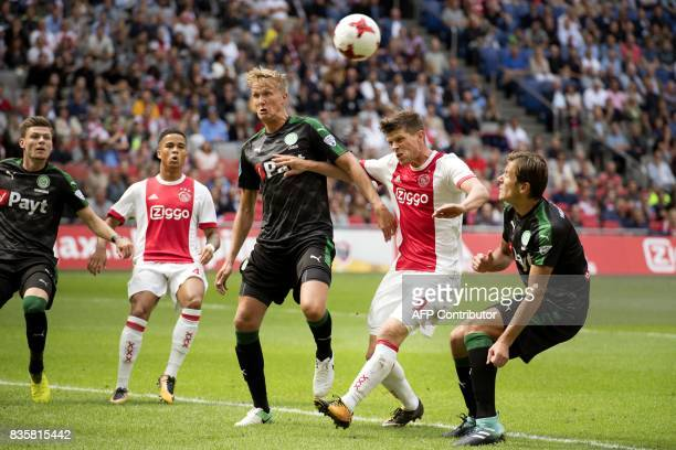 Klaas Jan Huntelaar of Ajax Amsterdam fights for the ball with Kasper Larssen of FC Groningen during the league match in Amsterdam on August 20 2017...