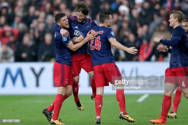 Klaas Jan Huntelaar of Ajax celebrates 01 with Lasse Schone of Ajax Nick Viergever of Ajax during the Dutch Eredivisie match between Feyenoord v Ajax...
