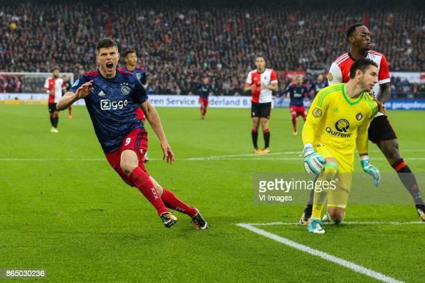 Klaas Jan Huntelaar of Ajax keeper Brad Jones of Feyenoord Ridgeciano Haps of Feyenoord during the Dutch Eredivisie match between Feyenoord Rotterdam...
