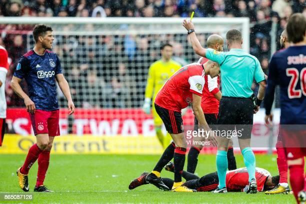 Klaas Jan Huntelaar of Ajax Kevin Diks of Feyenoord referee Danny makkelie Jeremiah St Juste of Feyenoord during the Dutch Eredivisie match between...