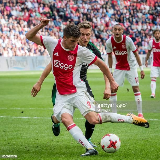 Klaas Jan Huntelaar of Ajax Ruben Yttergard Jenssen of FC Groningen during the Dutch Eredivisie match between Ajax Amsterdam and FC Groningen at the...
