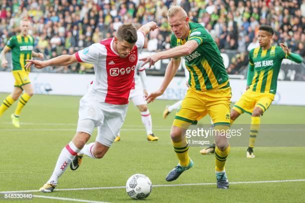 Klaas Jan Huntelaar of Ajax Tom Beugelsdijk of ADO Den Haag during the Dutch Eredivisie match between ADO Den Haag and Ajax Amsterdam at Car Jeans...