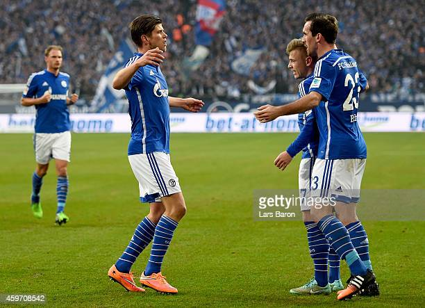 Klaas Jan Huntelaar of FC Schalke 04 celebrates with team mates Max Meyer of FC Schalke 04 and Christian Fuchs of FC Schalke 04 afer scoring his...