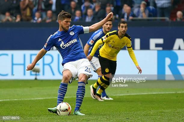 Klaas Jan Huntelaar of FC Schalke 04 scores his team's second goal from the penalty spot during the Bundesliga match between FC Schalke 04 and...