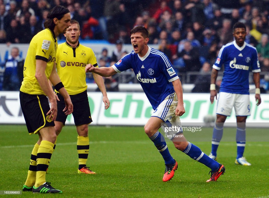 <a gi-track='captionPersonalityLinkClicked' href=/galleries/search?phrase=Klaas+Jan+Huntelaar&family=editorial&specificpeople=533040 ng-click='$event.stopPropagation()'>Klaas Jan Huntelaar</a> of Schalke celebrates after scoring his teams second goal during the Bundesliga match between FC Schalke 04 and Borussia Dortmund at Veltins-Arena on March 9, 2013 in Gelsenkirchen, Germany.