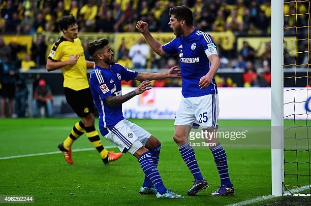 Klaas Jan Huntelaar of Schalke celebrates after scoring his teams first goal during the Bundesliga match between Borussia Dortmund and FC Schalke 04...