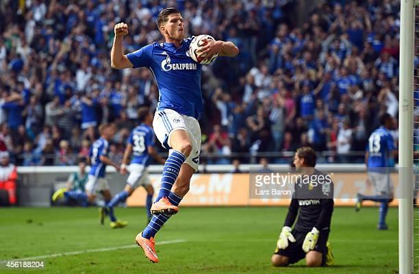 Klaas Jan Huntelaar of Schalke celebrates after team mate Erik Maxim Choupo Moting scored his teams second goal during the Bundesliga match between...