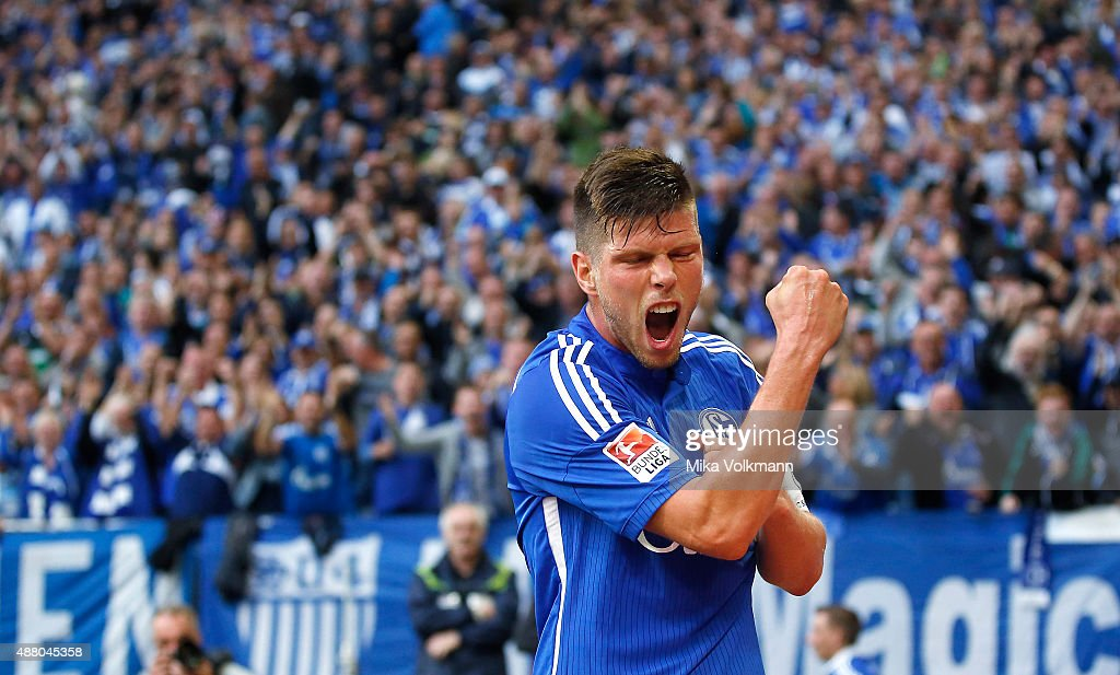 Klaas Jan Huntelaar of Schalke celebrates scoring his team's second goal (2:1) during the Bundesliga match between FC Schalke 04 and 1. FSV Mainz 05 at Veltins-Arena on September 13, 2015 in Gelsenkirchen, Germany.