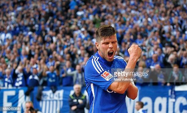 Klaas Jan Huntelaar of Schalke celebrates scoring his team's second goal during the Bundesliga match between FC Schalke 04 and 1 FSV Mainz 05 at...