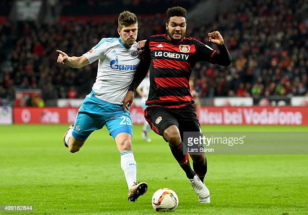 Klaas Jan Huntelaar of Schalke is challenged by Jonathan Tah of Leverkusen during the Bundesliga match between Bayer Leverkusen and FC Schalke 04 at...