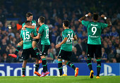 Klaas Jan Huntelaar of Schalke is comngtraulated by teammates after scoring a goal to level the scores at 11 during the UEFA Champions League Group G...