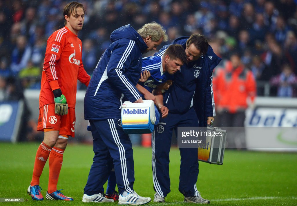 <a gi-track='captionPersonalityLinkClicked' href=/galleries/search?phrase=Klaas+Jan+Huntelaar&family=editorial&specificpeople=533040 ng-click='$event.stopPropagation()'>Klaas Jan Huntelaar</a> of Schalke leaves injured the pitch during the Bundesliga match between FC Schalke 04 and Borussia Dortmund at Veltins-Arena on March 9, 2013 in Gelsenkirchen, Germany.