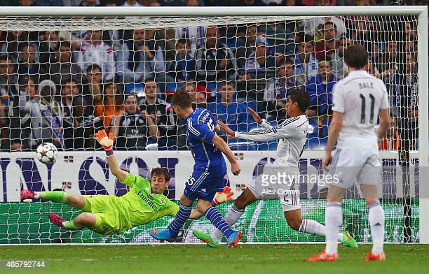 Klaas Jan Huntelaar of Schalke shoots past goalkeeper Iker Casillas of Real Madrid CF to score their second goal during the UEFA Champions League...