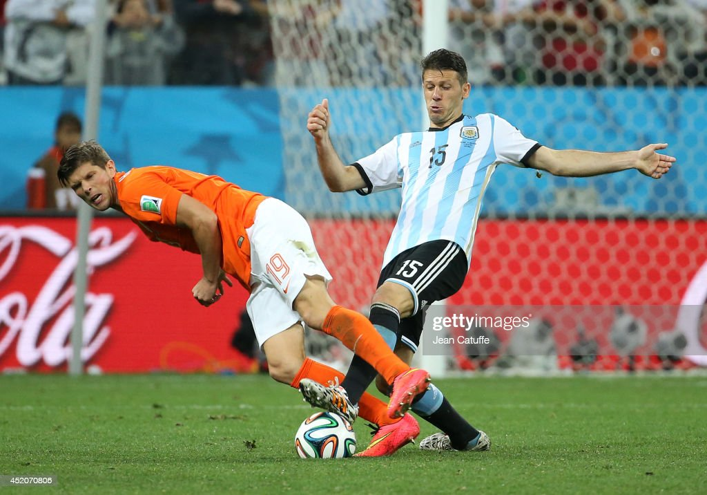 Klaas Jan Huntelaar of the Netherlands and Martin Demichelis of Argentina in action during the 2014 FIFA World Cup Brazil Semi Final match between Netherlands and Argentina at Arena de Sao Paulo on July 9, 2014 in Sao Paulo, Brazil.