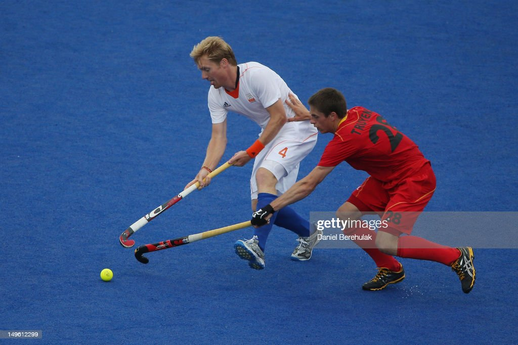 Klaas Vermeulen of the Netherlands is pursued by Jerome Truyens of Belgium on Day 5 of the London 2012 Olympic Games at Riverbank Arena on August 1, 2012 in London, England.